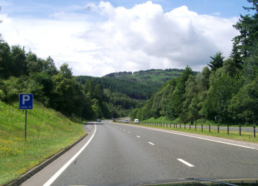 Motorway and mountains in Scotland, seen through Jeep windscreen.